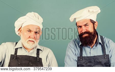Mature Bearded Chef. Tired Of Cooking. Masters Of Kitchen. Family Dinner. Father And Son Cooking Tog