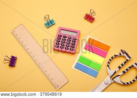 Creative Flat Lay. Back To School - School Supplies On Yellow Background