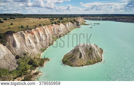 Cement Pit With Green Water