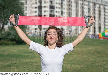Young Sportive Woman Doing Fitness Exercises On Green Grass In Warm Summer Day Outdoors