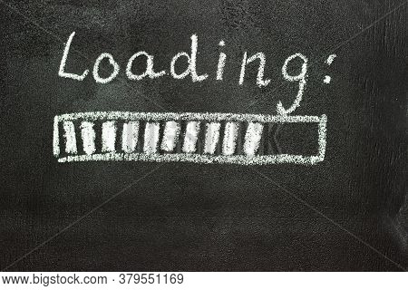 The Loading Process Is Shown In White On A Chalkboard. Stop Motion Animation.