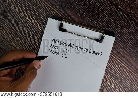 Are You Allergic To Latex. No Or Yes? Write On A Paperwork. Supported By An Additional Services Isol