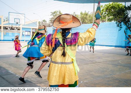 Lima, Lima / Peru - November 11 2016: Young Students Dressed In A Typical Peruvian Dance Costume Hol