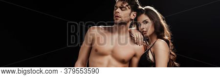 Panoramic Shot Of Woman In Bra Looking At Camera And Embracing Shirtless Boyfriend Isolated On Black