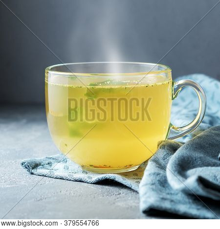 A Cup Of Warming Home Broth On A Concrete Background.