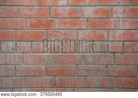 The Wall Of The Building Is Made Of Old White Brick. Background For Text, Posters. The Brick Is Dest