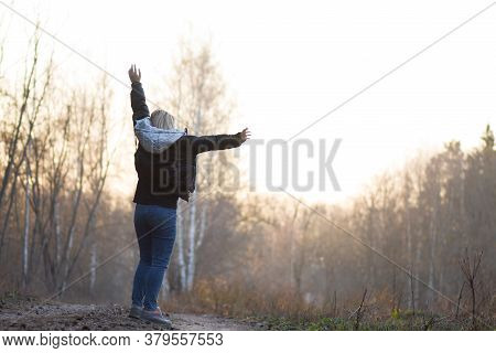 Freedom And Enjoying Nature Concept. Carefree Woman Enjoying Nature