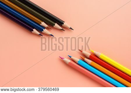 Set Of Colored Bright Pencils Lie Opposite Dark Pencils On Pink Pastel Background, Flat Lay. Pencils
