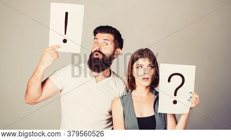 A Woman And A Man A Question, Exclamation Point. Couple In Quarrel. Question Mark. Pensive Man And A