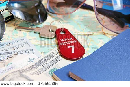 Money Passport And Villa Keys. Everything You Need For Vacation. Money, Glasses, Map, Key To Villa.