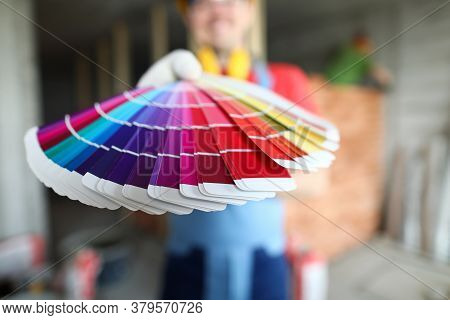 Builder Holds Out Palette Trendy Colors For Repair. Designer Offers Choice Colors For Apartment Reno
