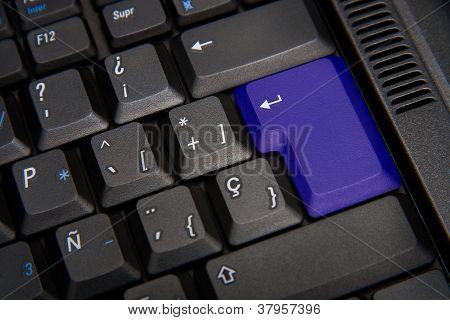 Black Keyboard With Blue Key
