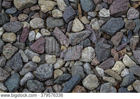 Small Rough Stones Texture Background Close-up The Rough Texture Of The Stone