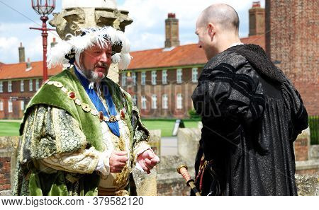 Hampton Court / London, Uk - 30 June 2014: Actors In The Characters Of King Henry Viii And Cardinal