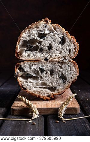 Olive Sourdough Bread Cut In Two To Reveal Its Crumb