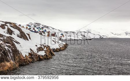 Greenlandic Fjord Rocky Shores Landscape With  Settlement On The Hill In A Distance, Kangamiut, Gree