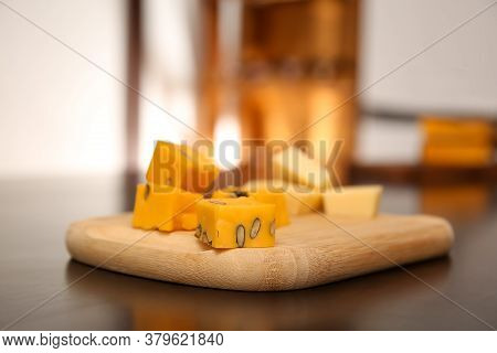 Pieces Of Delicious Gouda Cheese On Table, Closeup