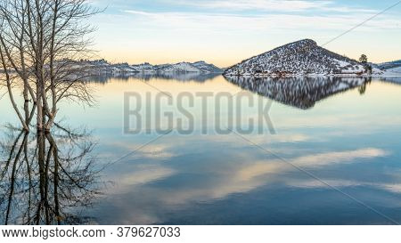 Winter dusk over mountain lake - Horsetooth Reservoir, a part of Big Thompson Project and a popular recreation destination near Fort Collins in northern Colorado.