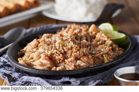 filipino food - pork sisig in cast iron pan