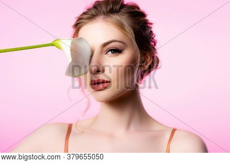 Elegant Beautiful Blonde Woman Holding Calla Flower Near Face Isolated On Pink