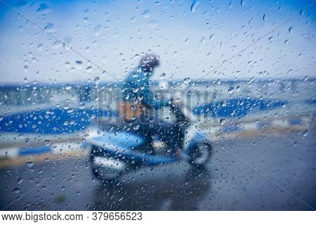 A Person Passing Through 2nd Hoogly Bridge On A Scooter Under Rain, Monsoon Image Of Kolkata, West B