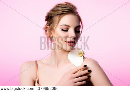 Elegant Beautiful Blonde Woman Holding Calla Flower On Shoulder Isolated On Pink