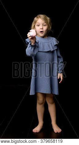 Beautiful Smiling Girl Taking Photo With Toy Camera, Adorable Barefoot Kid In Blue Dress Posing In S
