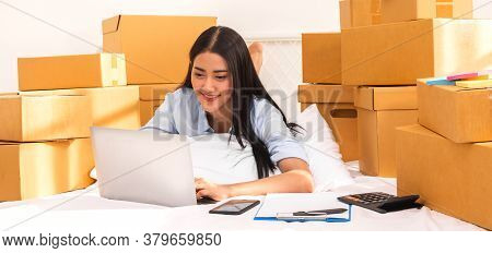 Young Smiling Beautiful Owner Asian Woman Freelancer Sme Business Online Shopping Working On Laptop