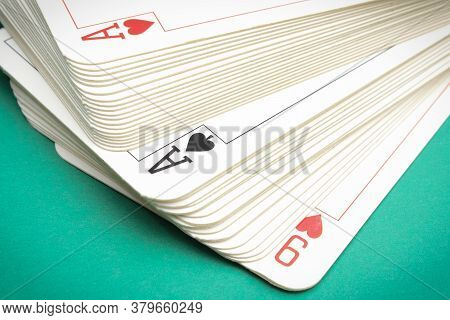 Game Card On Green Background. Concept Of Gambling Risk