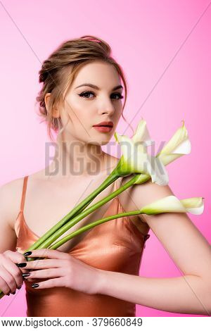 Elegant Beautiful Blonde Woman Holding Calla Flowers Isolated On Pink