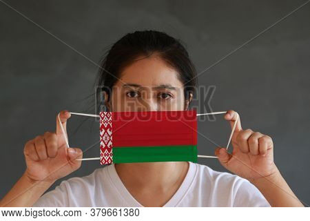 A Woman In White Shirt With Belarus Flag On Hygienic Mask In Her Hand And Lifted Up The Front Face O