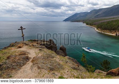 Peschanya Bay, Lake Baikal, Russia - July 17 2020: View From A Cliff At Coastline With Forest, Boat