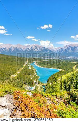 View From Grassi Lakes Trail Overlooking Rundle Forebay Lake And The Town Of Canmore With The Canadi