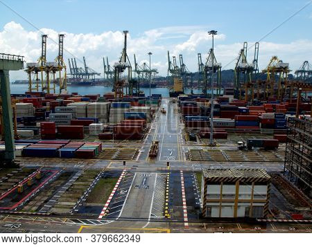 Singapore, March 8, 2016: Area Where Dozens Of Containers Are Stored At The Singapore Container Port
