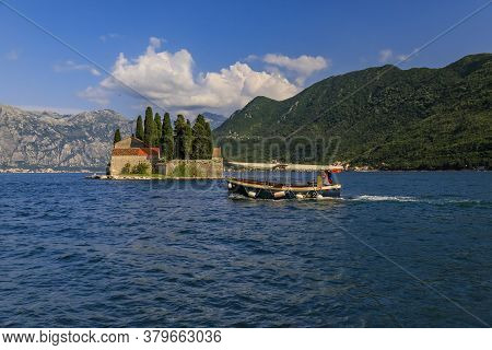 Perast, Montenegro - June 01 2019: Tourist Boat By Saint George Island With A Centuries-old Monaster