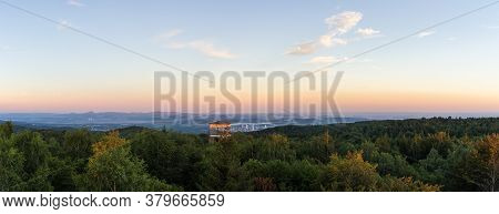 Watchtower Jerabina In Ore Mountain With City Litvinov And Forest At Blue Hour. Czech Landscape
