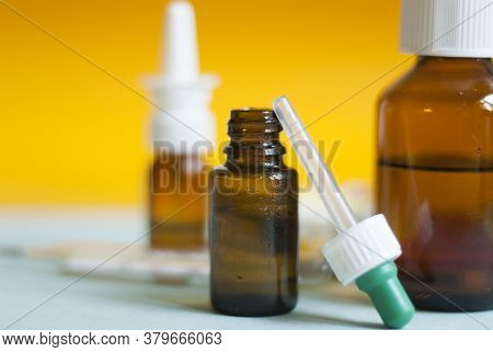 Medicines For Colds, Flu, Viral Diseases. Cough And Cold Remedies. Glass Jars With Syrup, Colored Ta