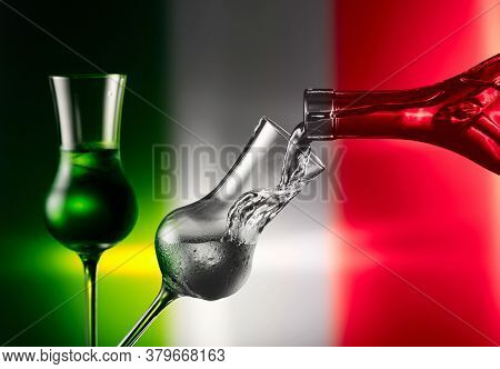 Steamed Glass With Tequila On A Background Of Mexican Flag. Pouring Tequila In Glass With Natural Ic