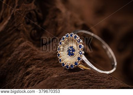 Trendy Youth Silver Ring With Blue Crystals On Brown Background