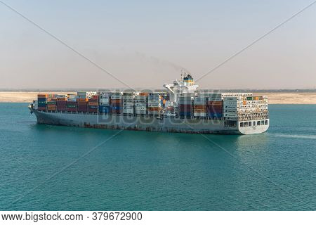 Suez, Egypt - November 14, 2019: Container Vessel Ship Amoliani Passing Suez Canal In Egypt. The Sue