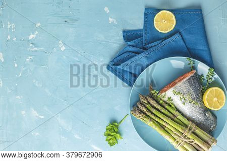 Fresh Raw Asparagus With Trout Fish, Lemon And Parsley, Shrimp, Prawn In Blue Ceramic Plates With Na