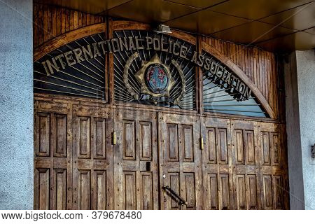 Kharkiv, Ukraine - July 20, 2020: Wooden Massive Door With A Sign And Logo Of The International Poli