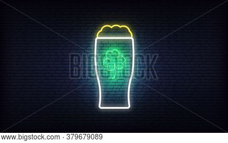 Irish Pub Neon Sign With Green Three Leaf Clover. Glowing Sign For Patricks Day