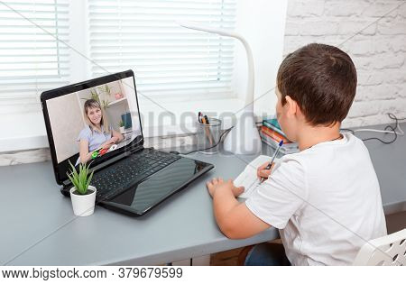 Schoolboy Is Having Video Chat With Teacher On Laptop Computer At Home. Home Schooling. School Boy I