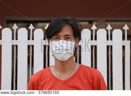 Masked Asian Man Prevent Germs. Tiny Particle Or Virus Corona Or Covid 19 Protection. Concept Of Com