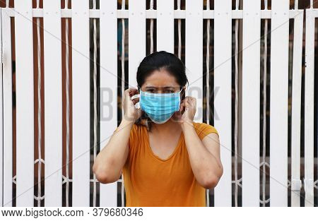 Asian Woman Wearing The Mask For Prevent Germs. Tiny Particle Or Virus Corona Or Covid 19 Protection