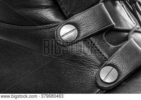Image Of A Buckle On A Black Leather Boot