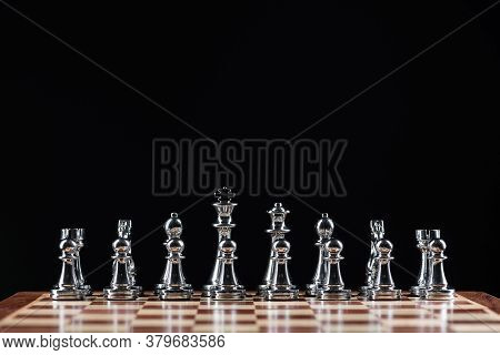 Silvery Chess Figures Standing On Chessboard. Intellectual Competition And Fight In Business. Strate