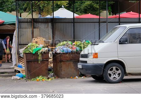 Dustbins Being Full With Various Garbage. Garbage Is Pile Lots Dump. Garbage Bins In City. Cardboard