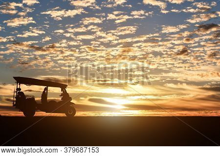 Silhouette Of Motor Tricycle At Sunset Background. (tuk Tuk Thailand)